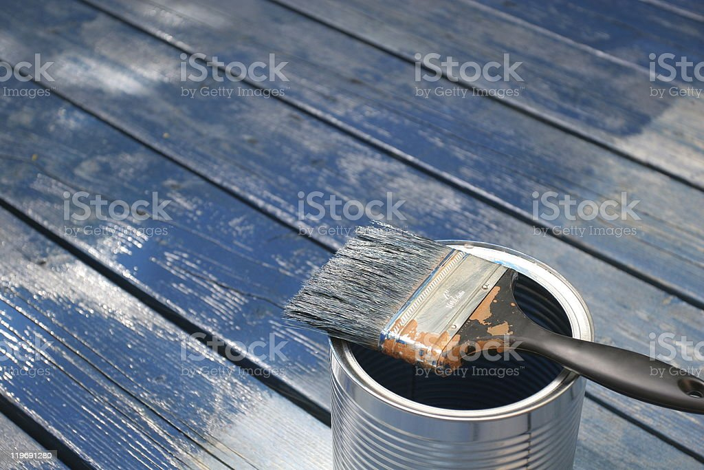Fresh painted wood, brush and paint can royalty-free stock photo