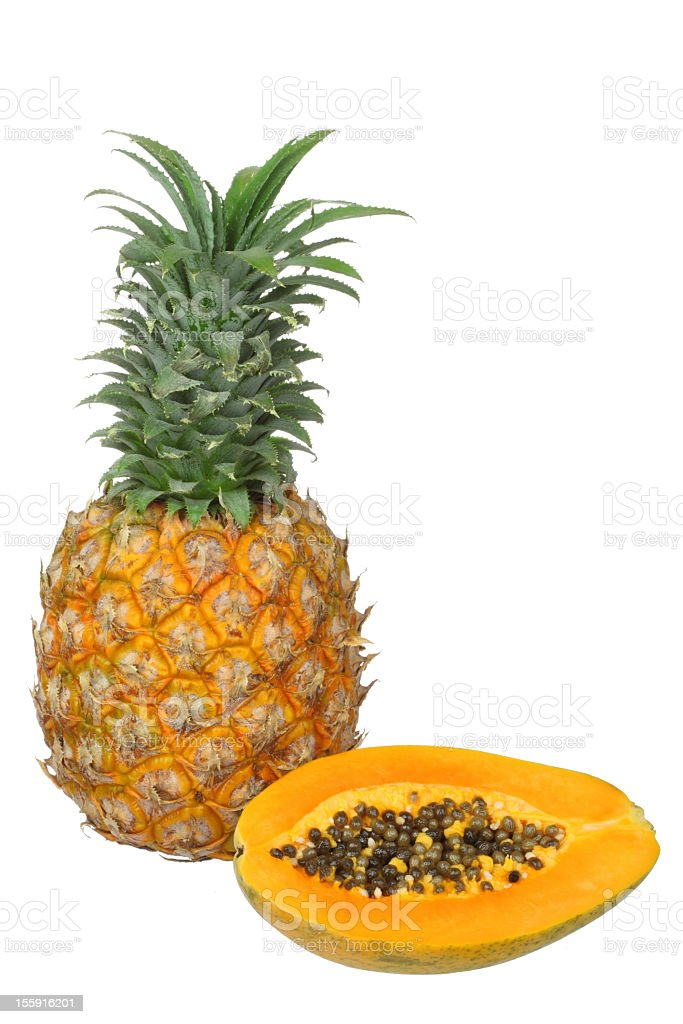 Fresh Papaya and Pineapple with Green Leaves stock photo
