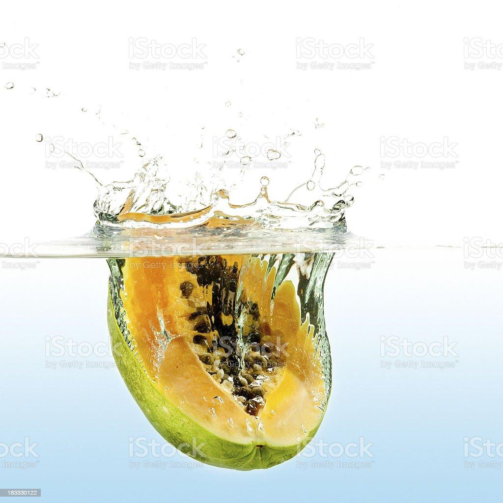 Fresh papaya half water splash royalty-free stock photo