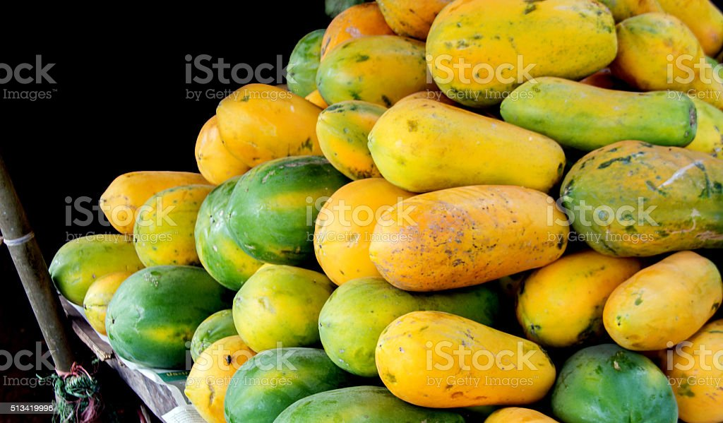 fresh papaya sell on market stock photo