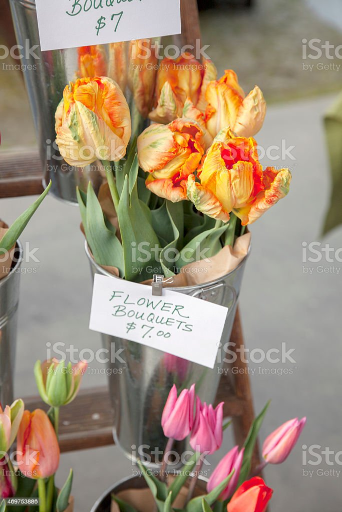 fresh parrot tulips for sale at a farmer's market stock photo
