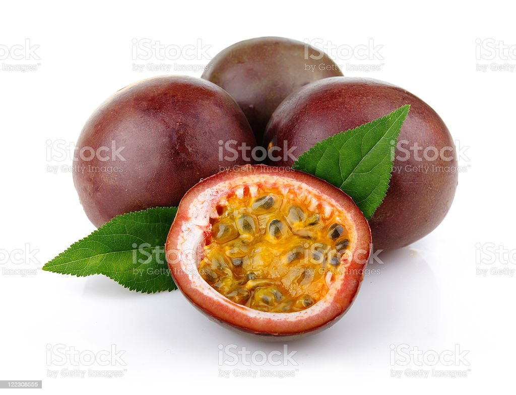 Fresh passion fruit with green leaves isolated stock photo