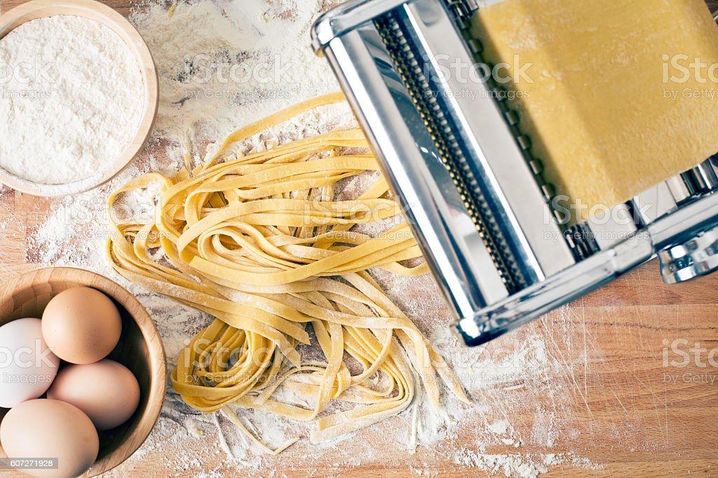 fresh pasta and pasta machine stock photo