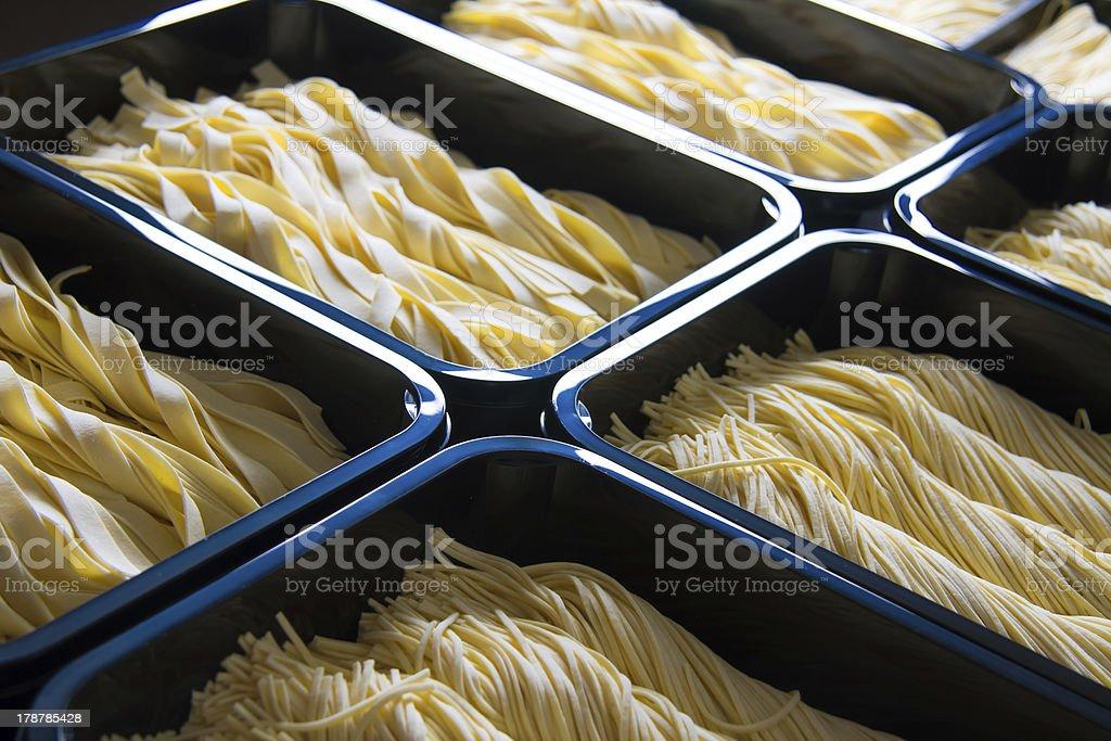 Fresh pasta in trays stock photo