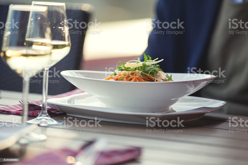 Fresh pasta served in outdoor restaurant stock photo