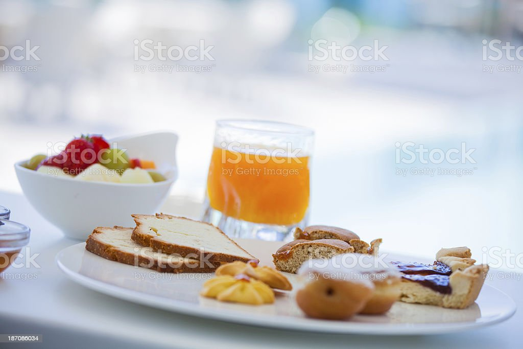 Fresh Pastry and Orange Juice Hotel Breakfast royalty-free stock photo