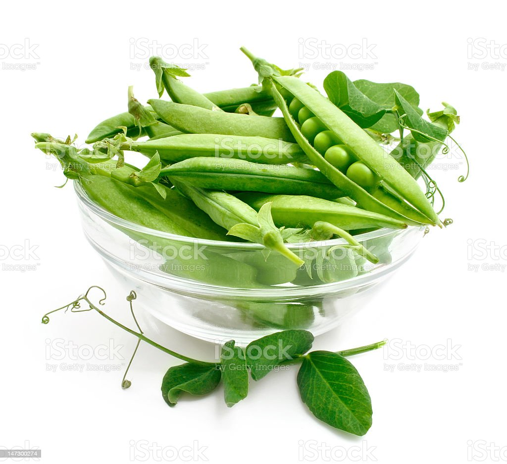 fresh pea in the pod with green leaves royalty-free stock photo