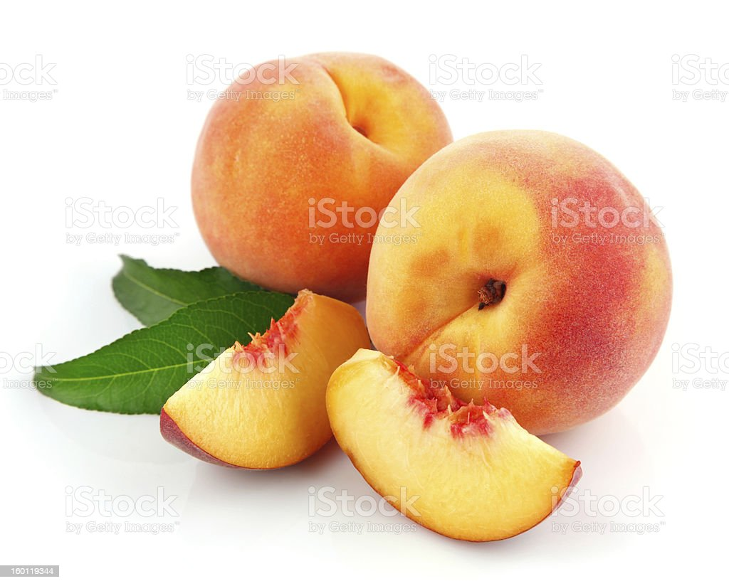 fresh peach fruits with green leaves royalty-free stock photo
