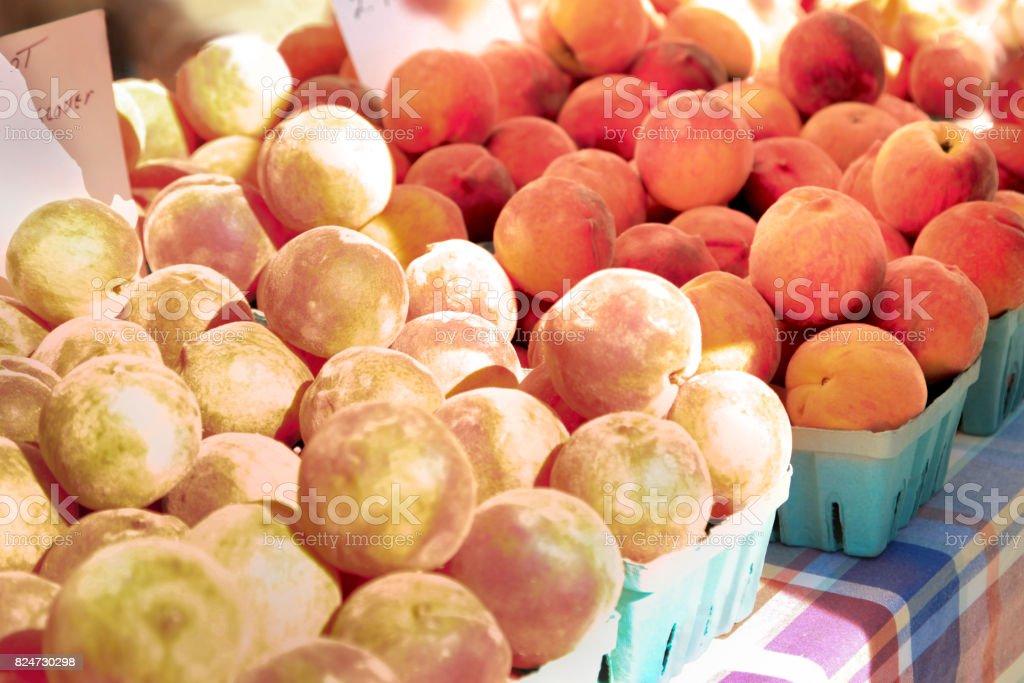 Fresh Peaches at Market Stall stock photo