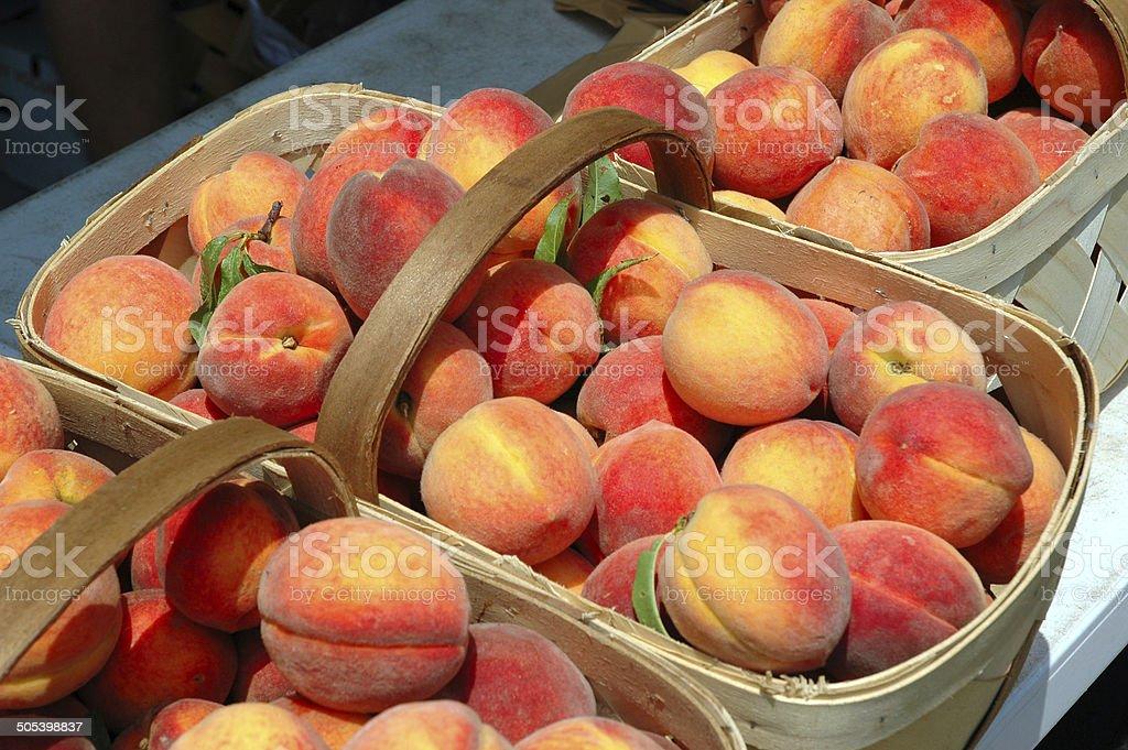 Fresh peaches in a basket stock photo