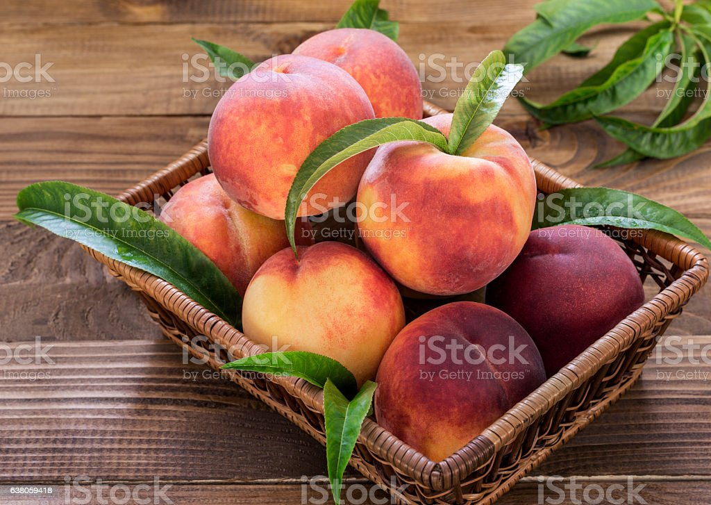 Fresh Peaches In a Basket stock photo