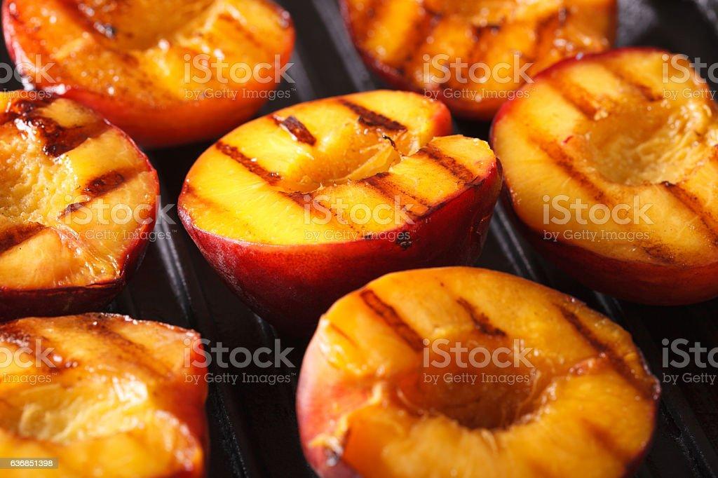 Fresh peaches on grill macro. Horizontal stock photo