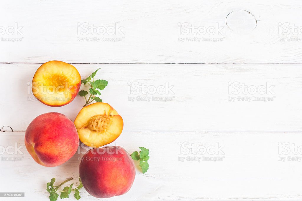 Fresh peaches on white background, top view, flat lay stock photo