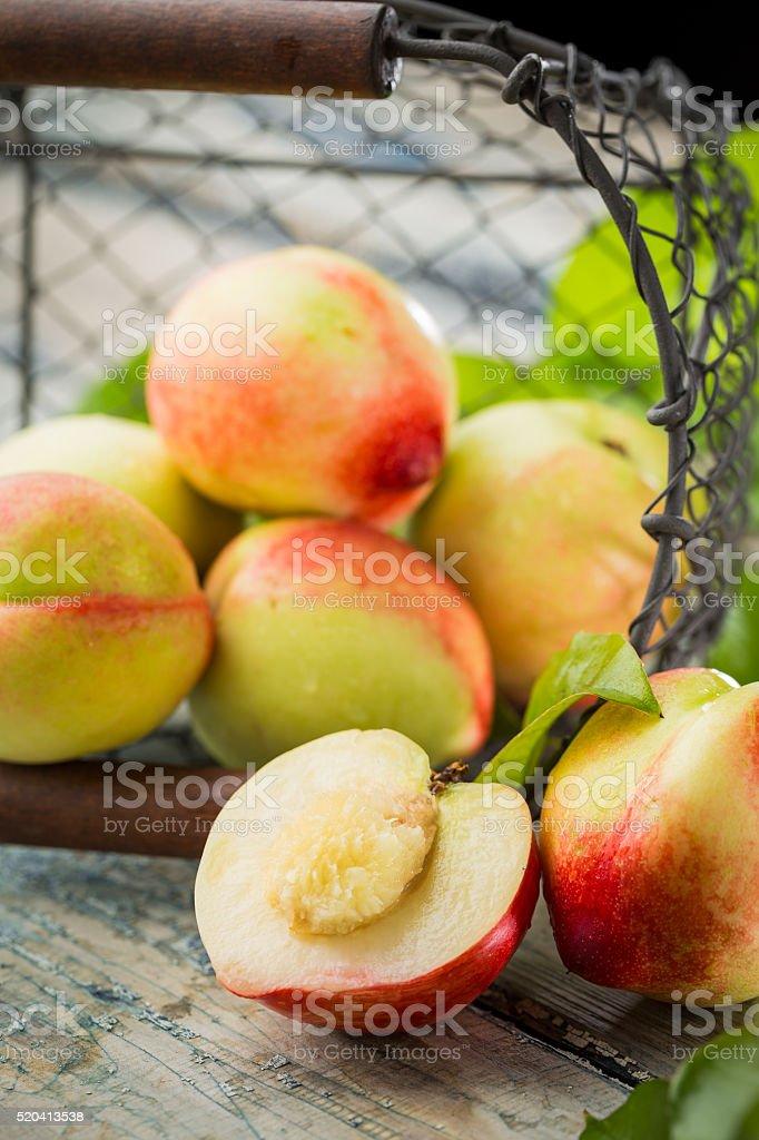 Fresh peaches on wooden table stock photo