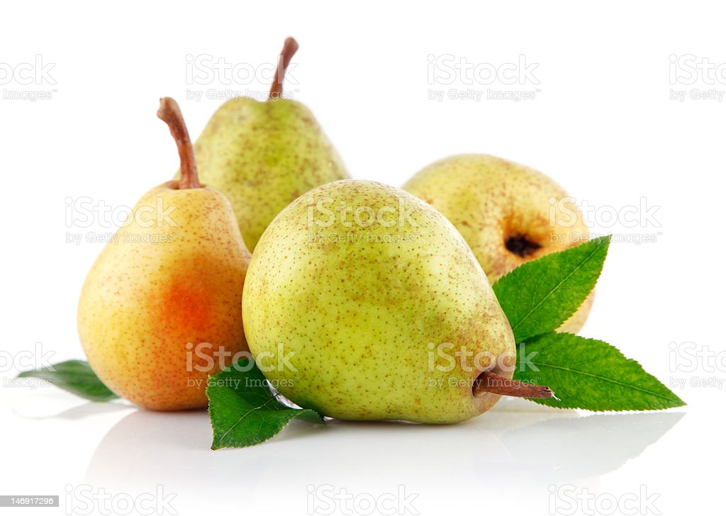 fresh pear fruits with green leaves stock photo