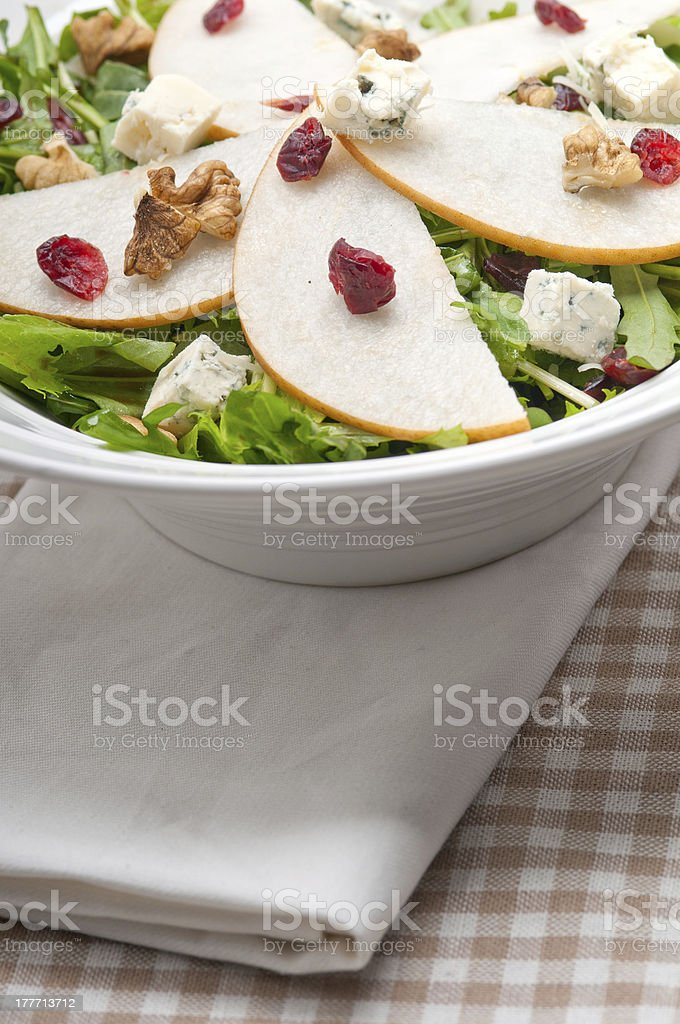 Fresh pears arugula gorgonzola cheese salad royalty-free stock photo