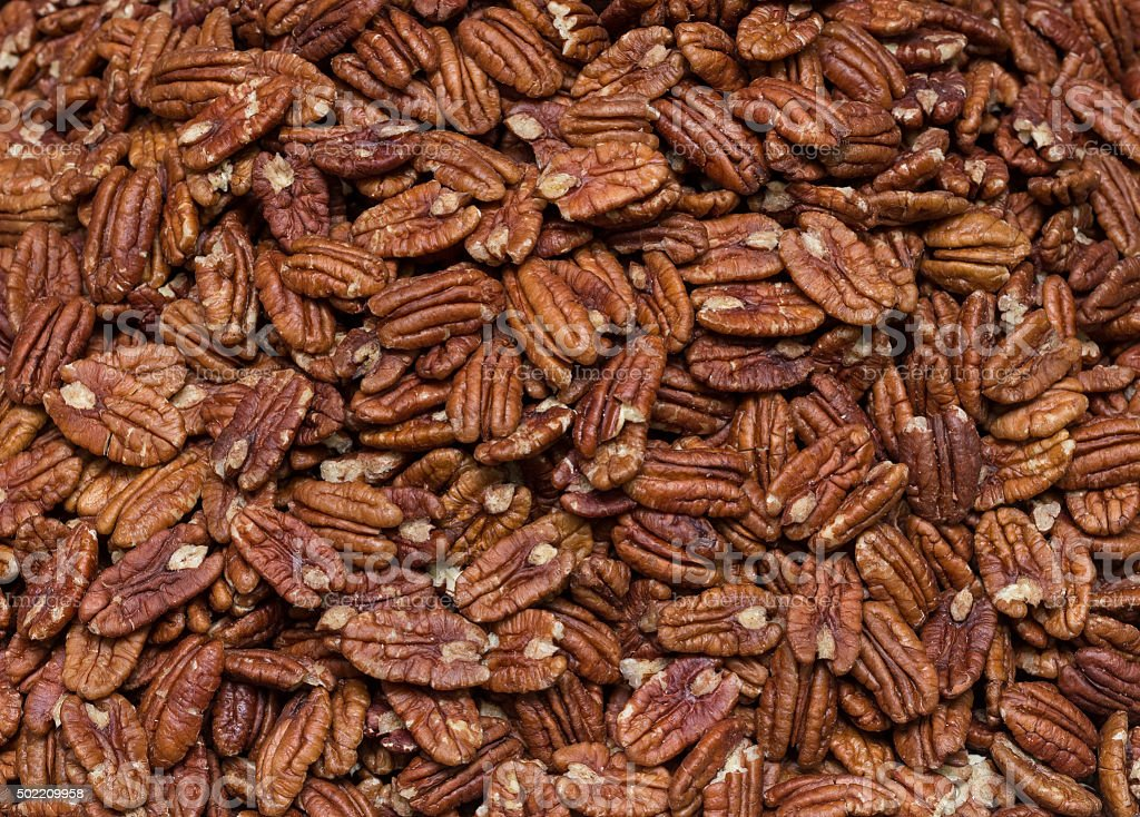 Fresh pecans bulk. pattern stock photo