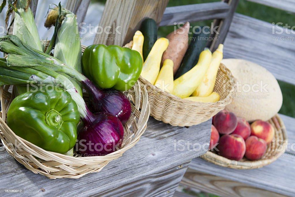 Fresh Picked Fruits & Vegetables outside on wooden shelves. stock photo
