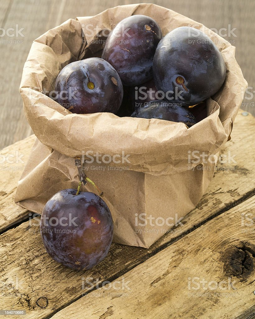 Fresh picked purple plums stock photo