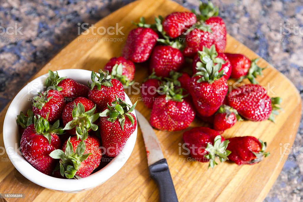 Fresh Picked Strawberries on the Cutting Board royalty-free stock photo