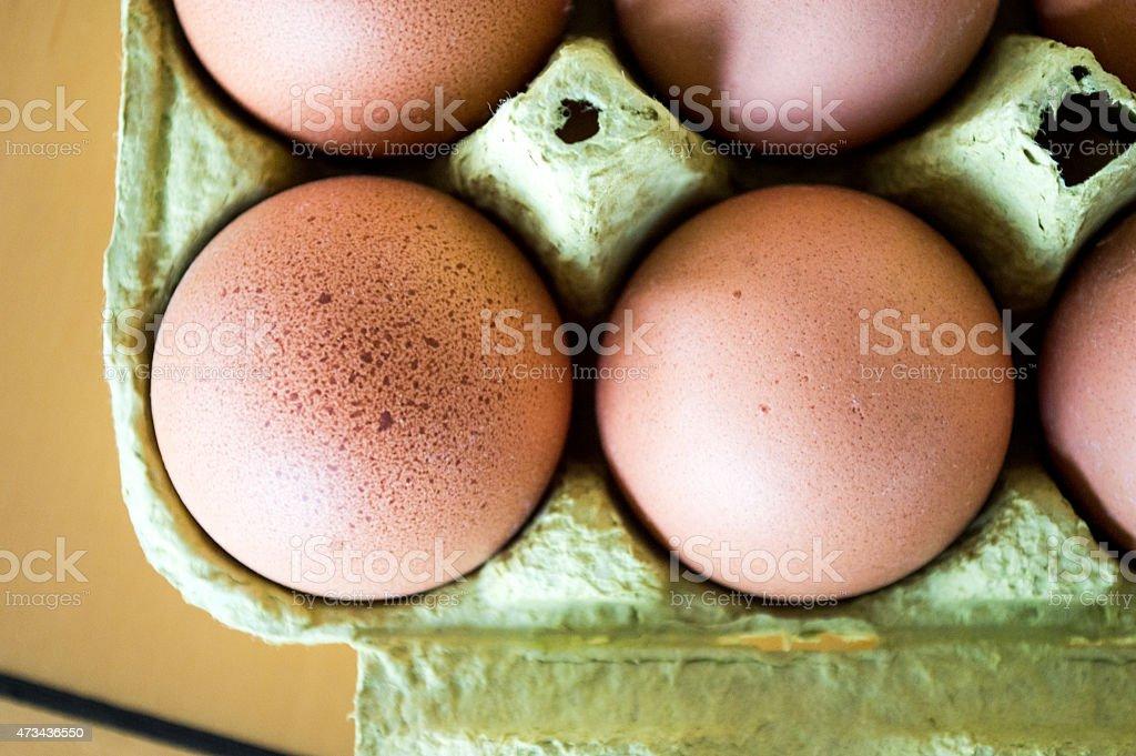 Fresh Pink Eggs in a Box/Carton royalty-free stock photo