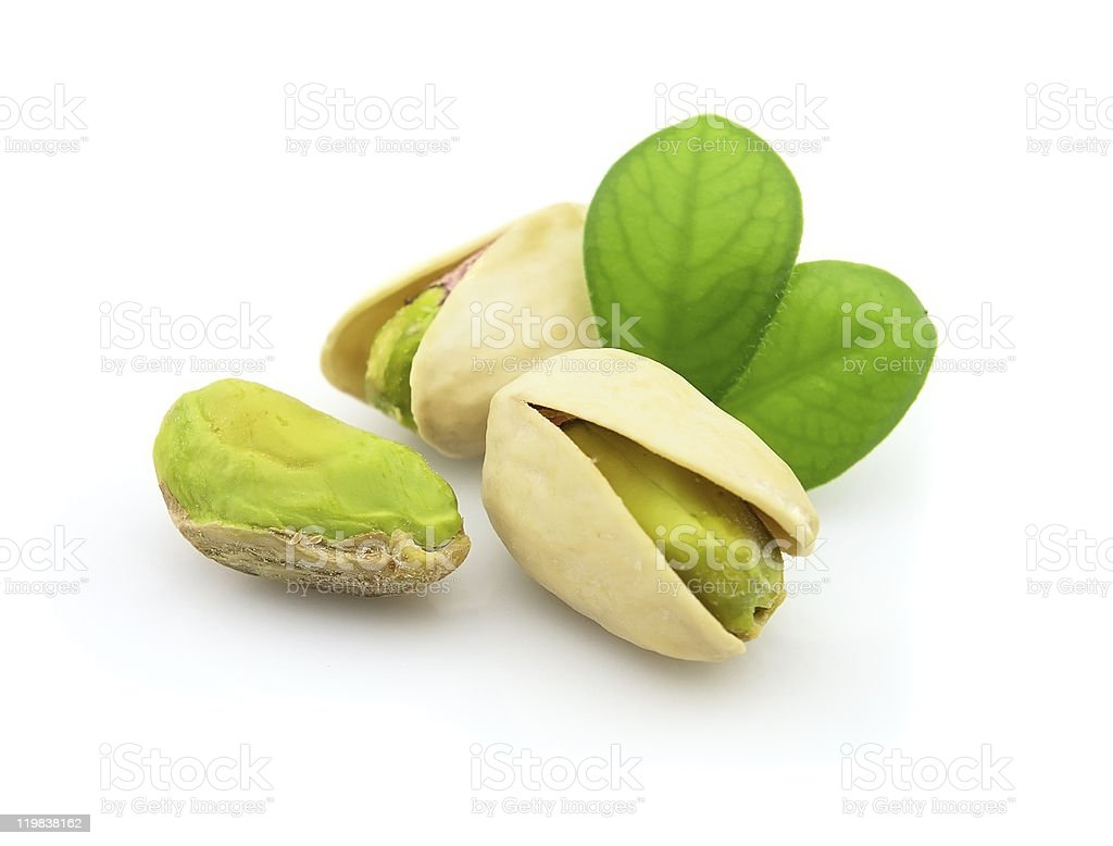 Fresh pistachio with leaves stock photo