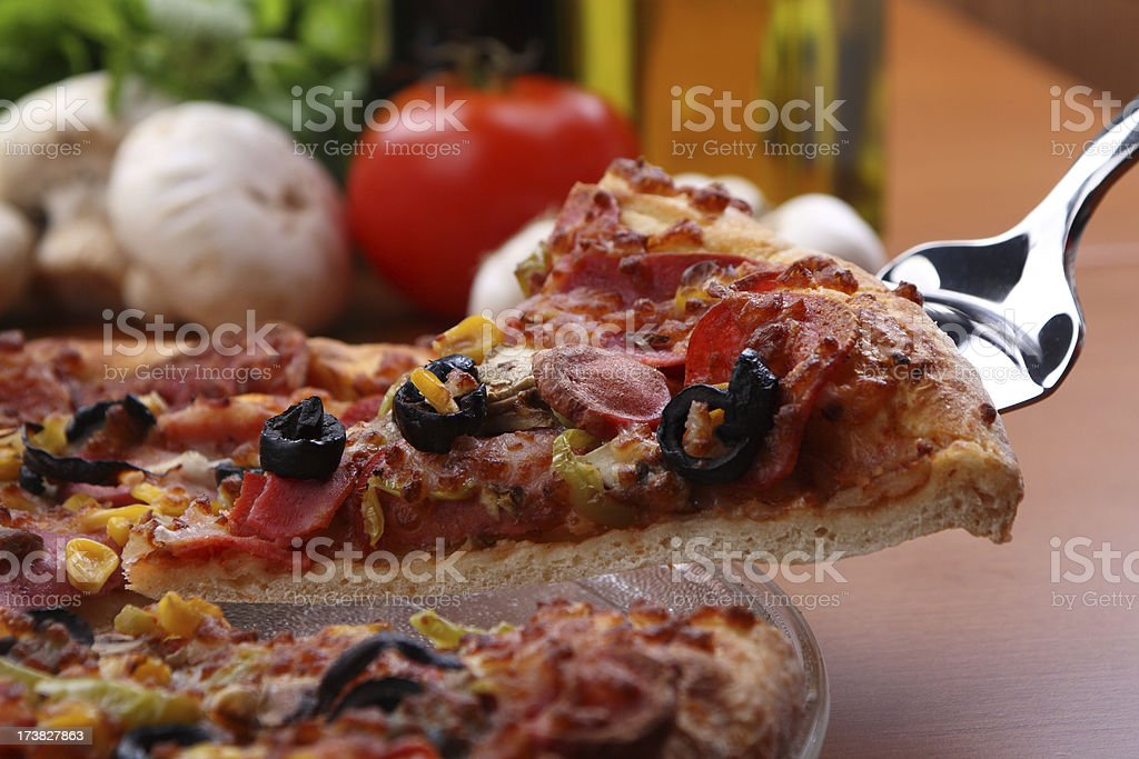 Fresh pizza being served royalty-free stock photo