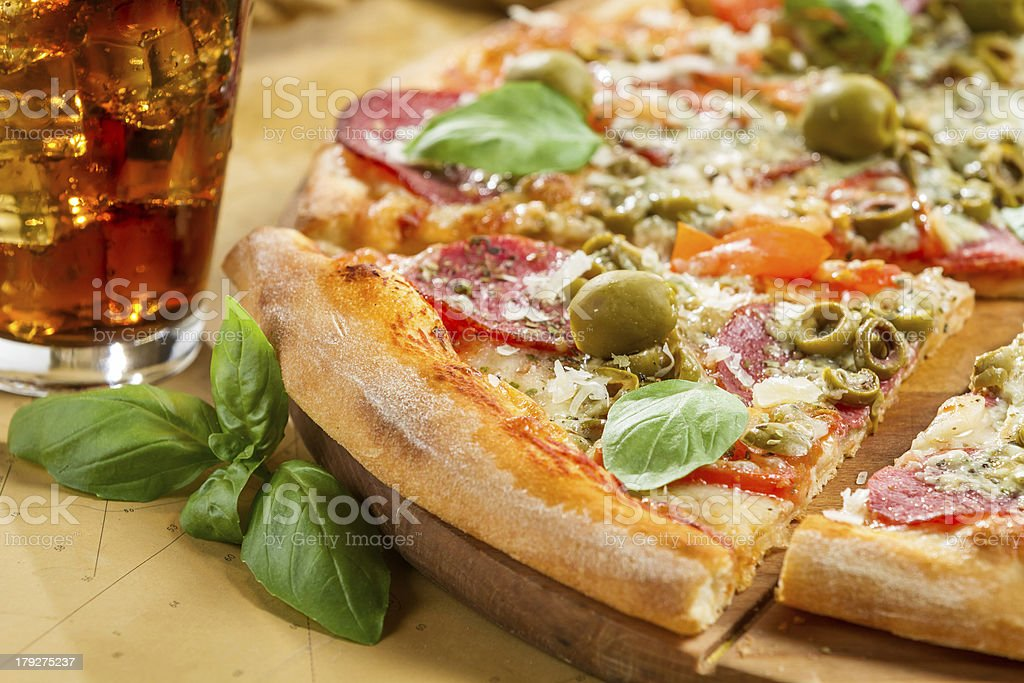 Fresh pizza with salami and olives royalty-free stock photo