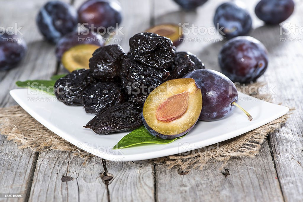 Fresh plums and prunes on a plate stock photo