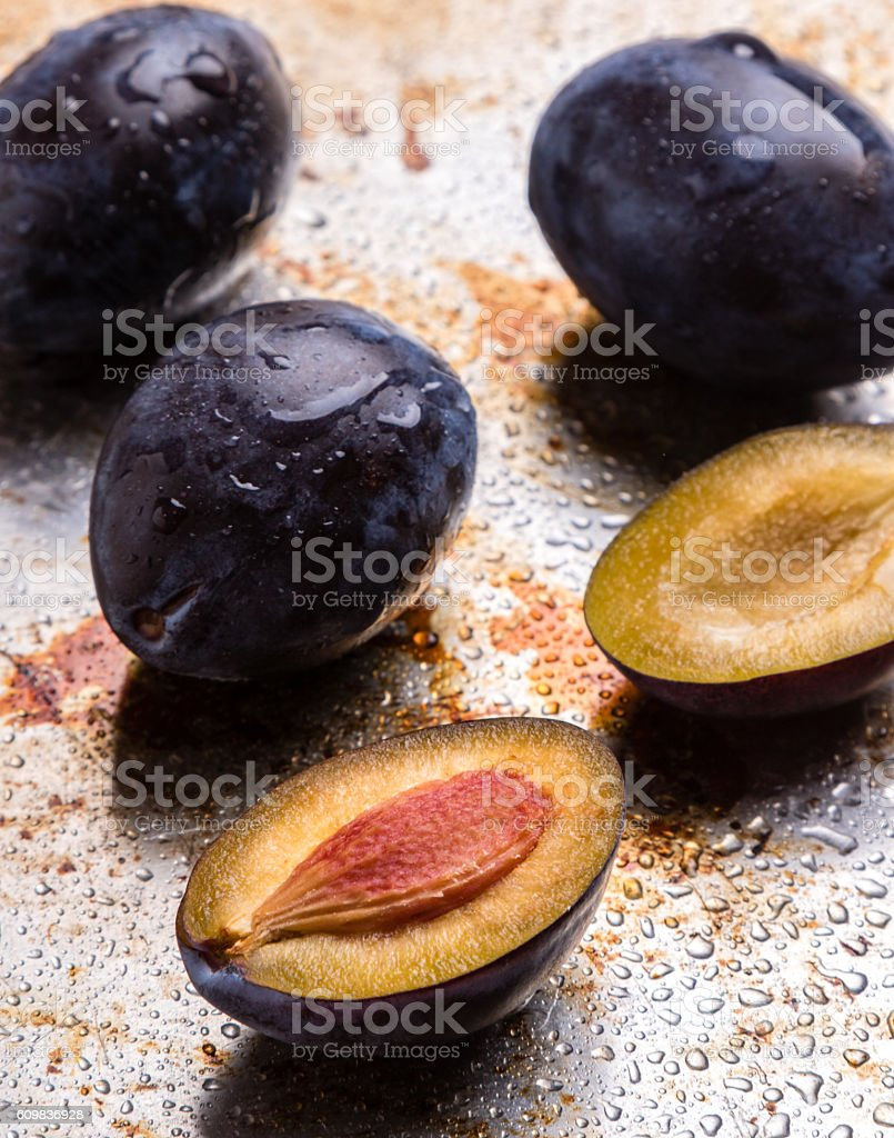 fresh plums on steel plate stock photo
