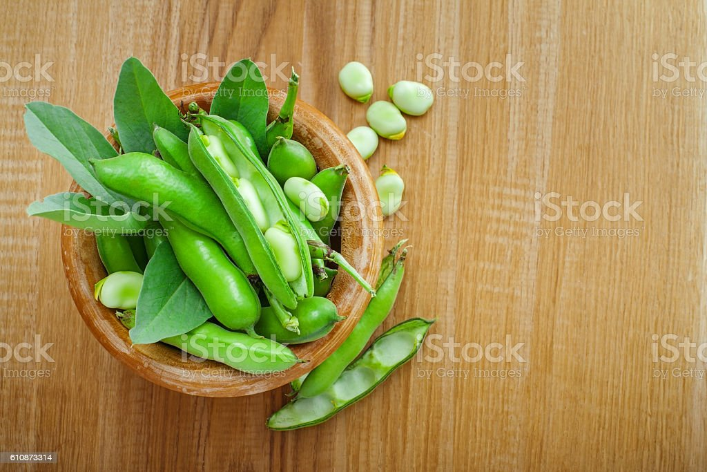 Fresh podded broad beans stock photo
