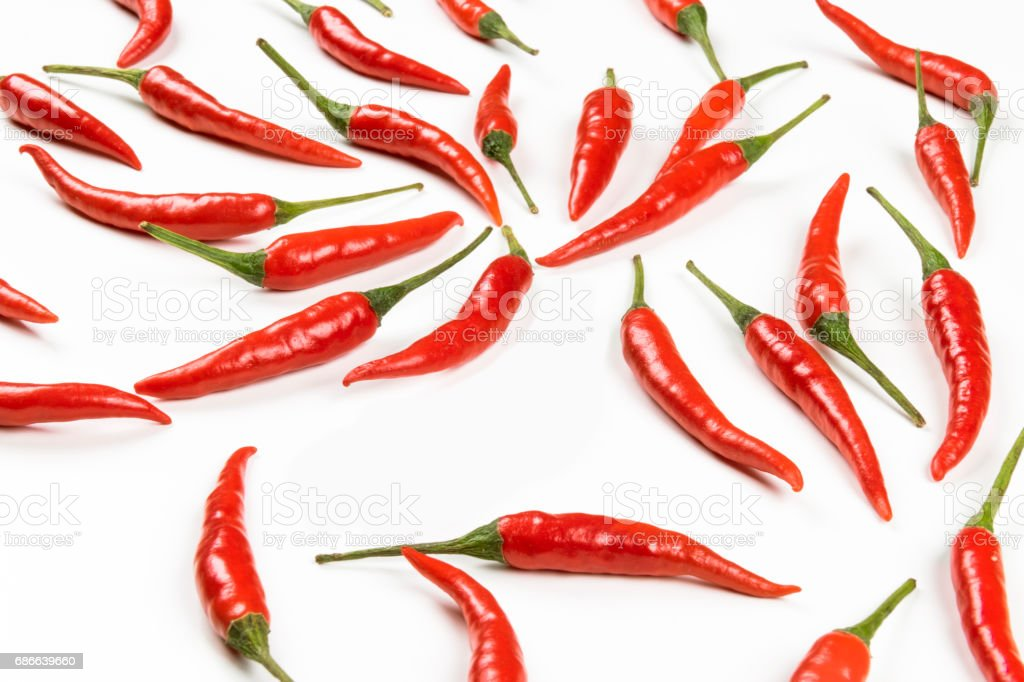 Fresh pods of red chili peppers on white background, close up stock photo