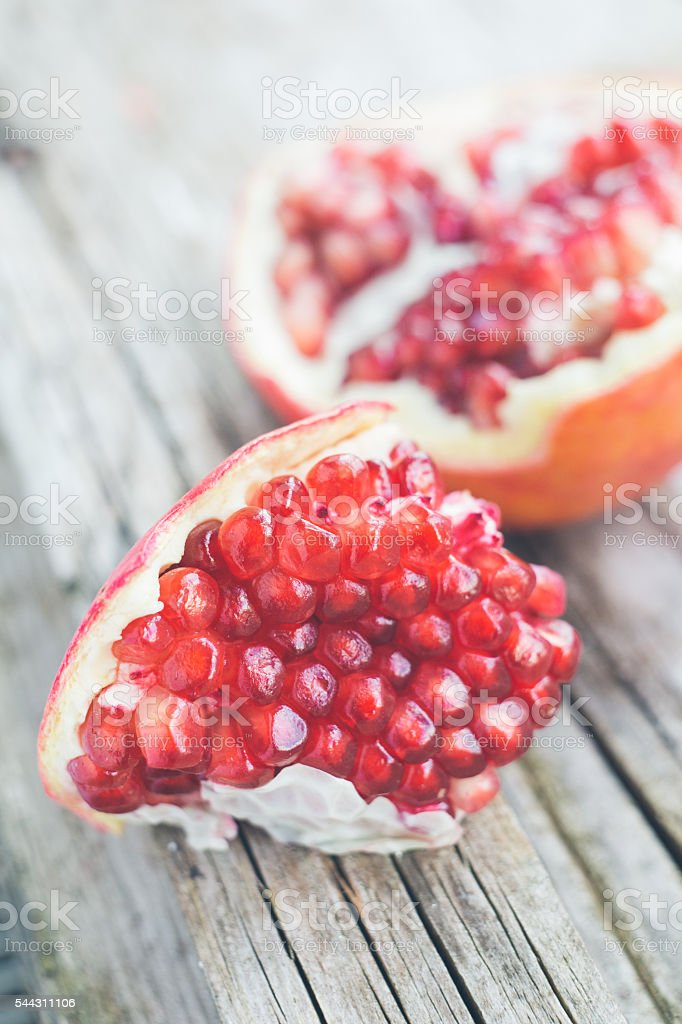 Fresh pomegranate on wooden plate stock photo
