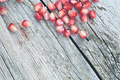 Fresh pomegranate on wooden plate
