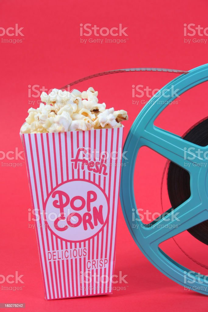 Fresh popcorn and reel stock photo