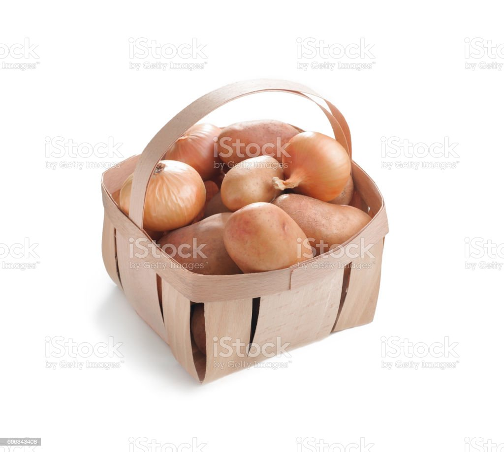 fresh potatoes and bulbs of onion in a wooden box isolated on white background stock photo