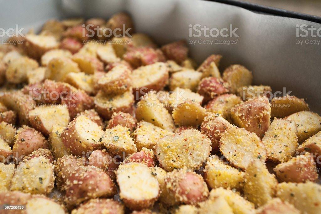 Fresh potatoes in caserole dish stock photo