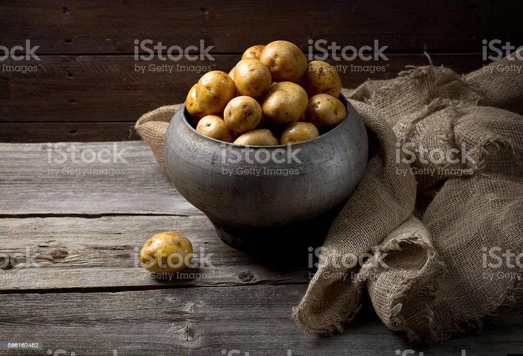 Fresh potatoes in old traditional Russian pot stock photo