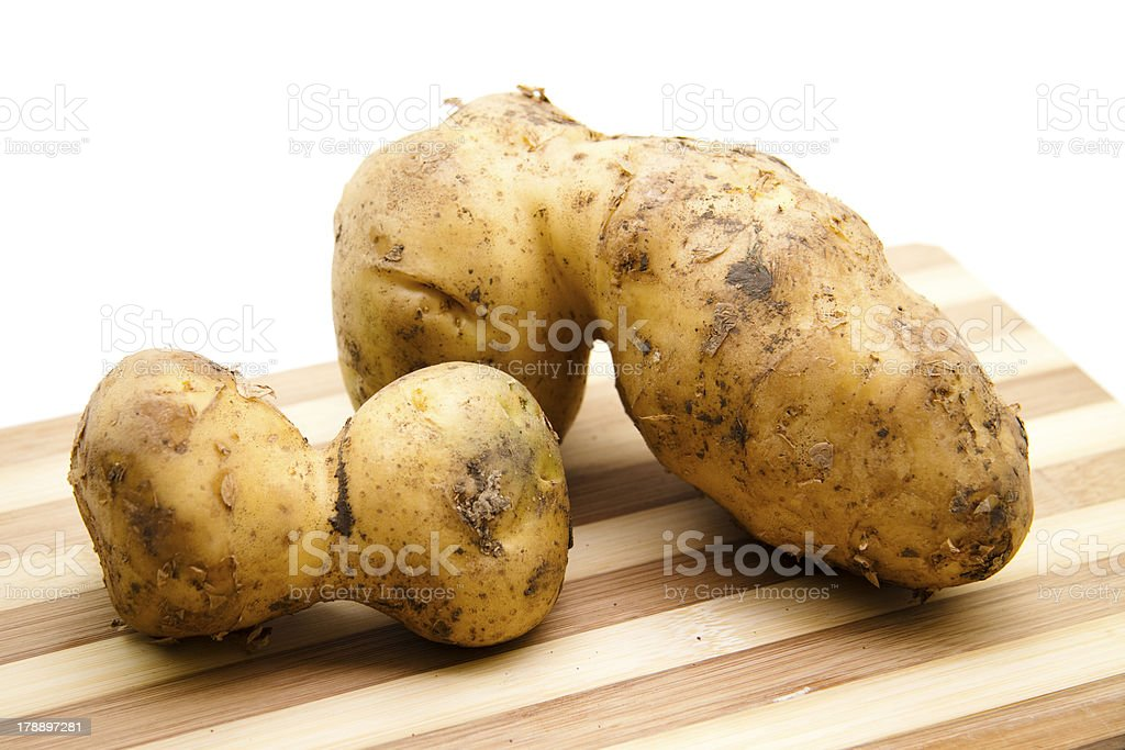 Fresh potatoes on edge board stock photo