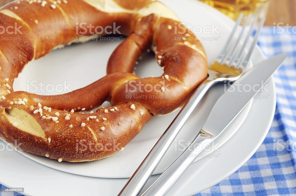 fresh Pretzel with beer glass typical Oktoberfest food royalty-free stock photo