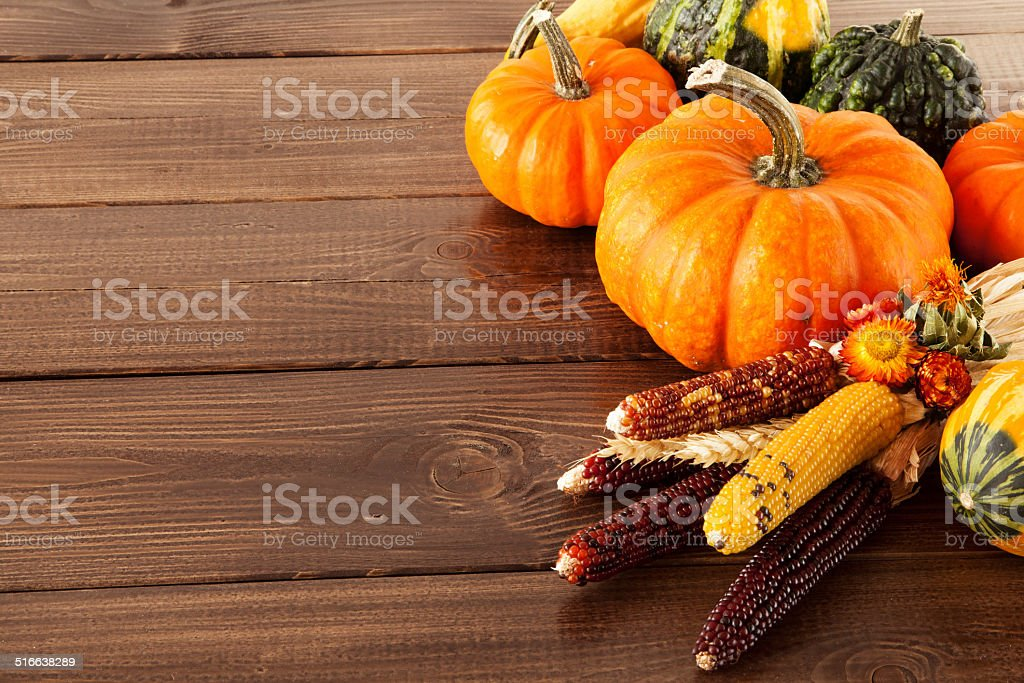 Fresh pumpkins on a wooden table stock photo