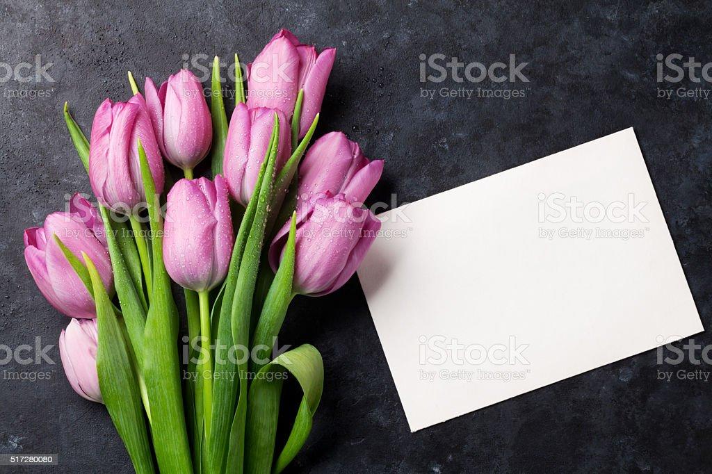 Fresh purple tulip flowers and greeting card stock photo