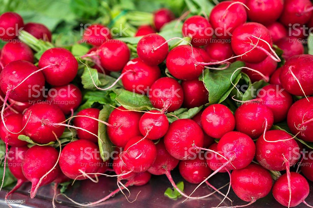 Fresh radishes on the market stock photo