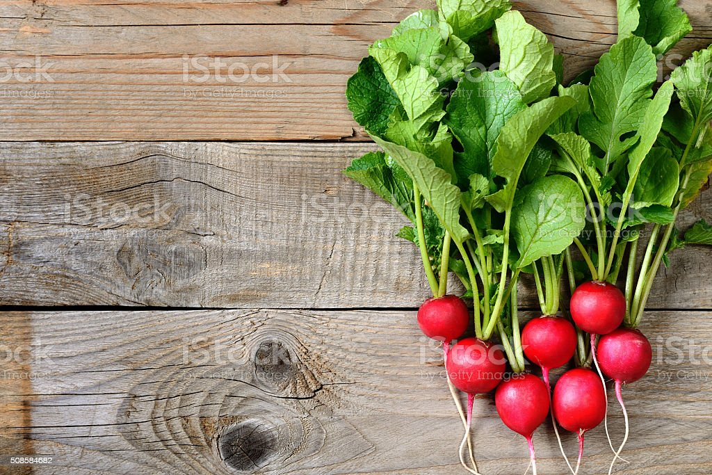 Fresh radishes on wooden table stock photo