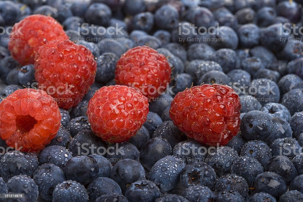 Fresh raspberries and blueberries royalty-free stock photo