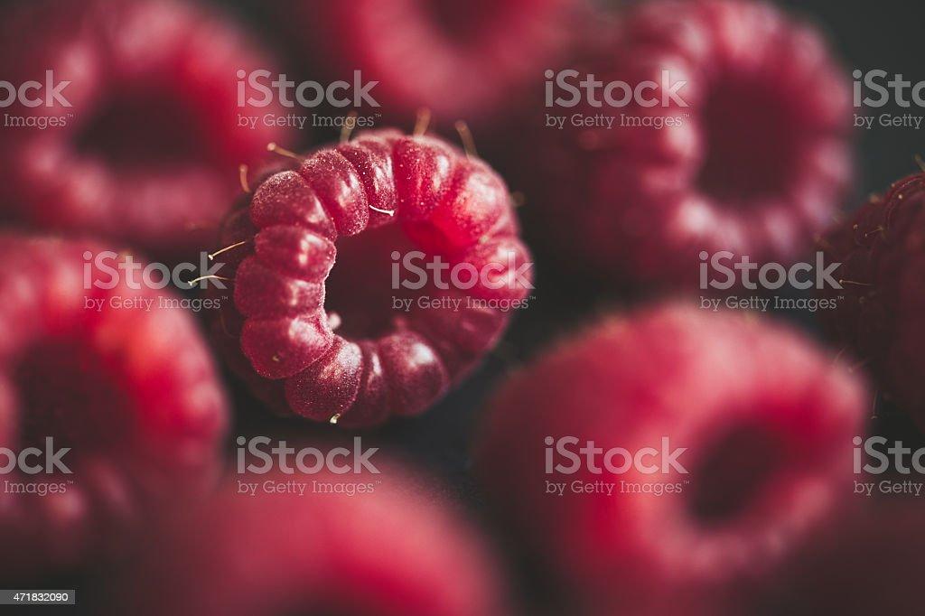 Fresh raspberries on black stock photo
