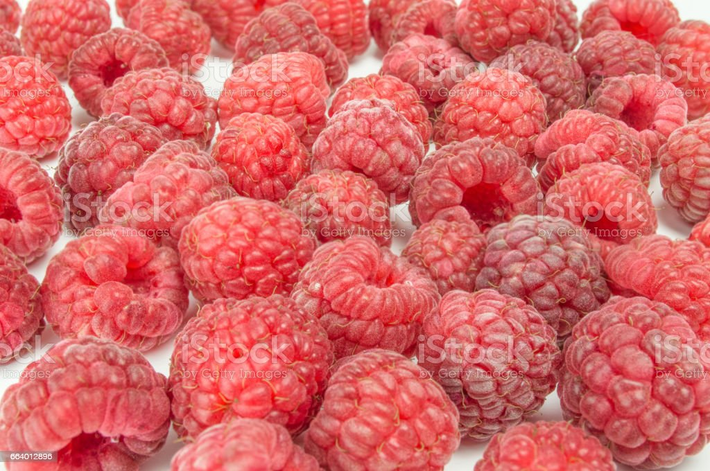 Fresh raspberries scattered on white background stock photo
