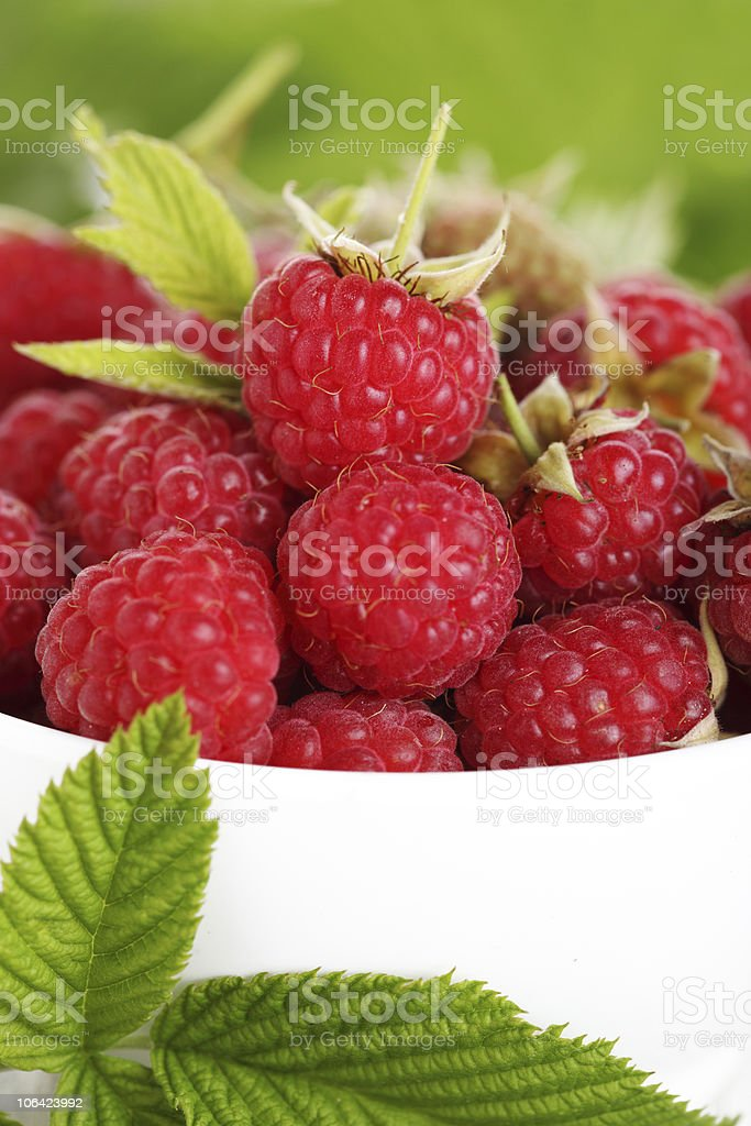 Fresh raspberry in a white bowl stock photo