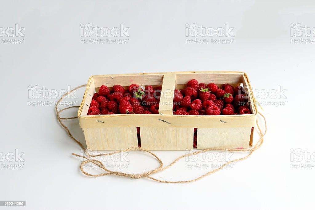 Fresh raspberry in pottle stock photo