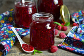 Fresh raspberry jam in a glass jar